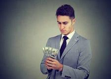 Homem de negócio novo ambicioso com dinheiro imagens de stock royalty free