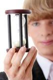 Homem de negócio novo com hourglass fotografia de stock royalty free
