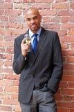 Homem de negócio novo com um vidro do vinho Fotografia de Stock