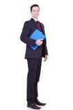 Homem de negócio novo com uma prancheta azul Imagem de Stock