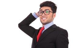 Homem de negócio novo confuso Fotografia de Stock Royalty Free
