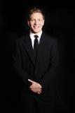 Homem de negócio novo de sorriso foto de stock royalty free