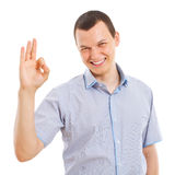 Homem de negócio novo feliz que mostra o sinal aprovado Imagens de Stock Royalty Free