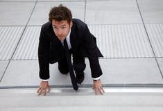 Homem de negócio novo na posição de começo Imagens de Stock Royalty Free
