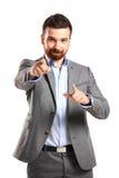 Homem de negócio novo que aponta à câmera Imagens de Stock Royalty Free