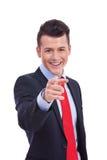 Homem de negócio novo que aponta em você foto de stock