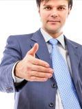 Homem de negócio novo que dá a mão para o aperto de mão Imagens de Stock Royalty Free