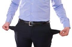 Homem de negócio que retira bolsos vazios. fotografia de stock