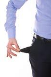 Homem de negócio que retira o bolso vazio. fotos de stock royalty free