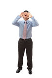 Homem de negócio novo que shouting para fora alta Imagem de Stock