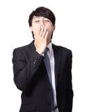 Homem de negócio Overworked que boceja Imagens de Stock Royalty Free