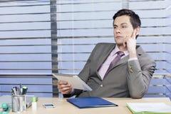 Homem de negócio pensativo Fotografia de Stock