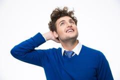 Homem de negócio pensativo de sorriso que olha acima Fotos de Stock Royalty Free