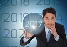 Homem de negócio pensativo no fundo digitalmente gerado que toca em 2017 Fotos de Stock