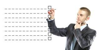Homem de negócio projetado em uma caixa da lista de verificação Imagens de Stock Royalty Free