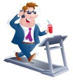 Homem de negócio que anda em uma escada rolante Foto de Stock Royalty Free