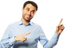 Homem de negócio que aponta acima do dedo Foto de Stock