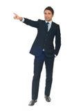 Homem de negócio que aponta ao espaço da cópia Fotografia de Stock Royalty Free