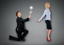 Homem de negócio que dá a flor imagens de stock royalty free
