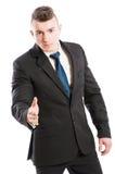Homem de negócio que dá a mão para o aperto de mão Fotografia de Stock
