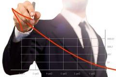 Homem de negócio que desenha uma seta de levantamento em um successf Foto de Stock