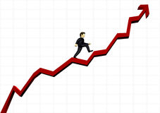 Homem de negócio que escala um gráfico financeiro Fotos de Stock Royalty Free