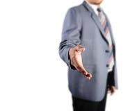 Homem de negócio que está para o aperto de mão Foto de Stock
