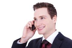 Homem de negócio que fala sobre o telemóvel Fotografia de Stock Royalty Free