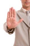 Homem de negócio que faz o sinal do batente Imagens de Stock