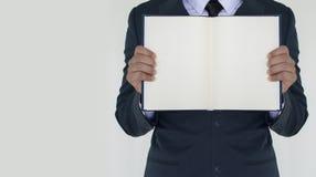 Homem de negócio que guarda o livro Foto de Stock Royalty Free