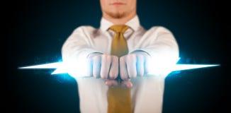 Homem de negócio que guarda o parafuso de relâmpago de incandescência em suas mãos Imagem de Stock