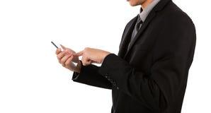 Homem de negócio que guarda o telefone móvel, esperto transparente de vidro Foto de Stock Royalty Free
