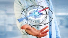 Homem de negócio que guarda um compasso da navegação - 3d rendido Foto de Stock Royalty Free