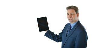 Homem de negócio que guarda uma tabuleta Fotos de Stock