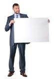 Homem de negócio que mantem uma bandeira em branco isolada Imagens de Stock