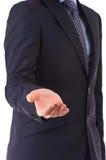 Homem de negócios que mostra a mão vazia. imagem de stock