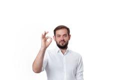 Homem de negócio que mostra o sinal aprovado Imagem de Stock Royalty Free