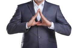 Homem de negócio que mostra o sinal da casa Imagens de Stock
