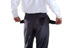 Homem de negócio que mostra seus bolsos vazios Fotografia de Stock Royalty Free