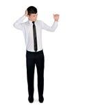 Homem de negócio que pensa e que apresenta algo Imagens de Stock Royalty Free