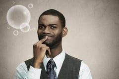 Homem de negócio que pensa, sonhando acordado sobre algo Imagens de Stock