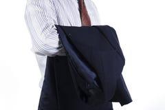 Homem de negócio que prende seu revestimento do terno Fotografia de Stock Royalty Free