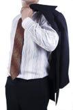 Homem de negócio que prende seu revestimento do terno Fotos de Stock