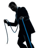 Homem de negócio que puxa uma silhueta da corda Imagens de Stock Royalty Free