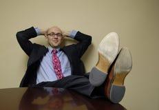 Homem de negócio que relaxa Fotografia de Stock
