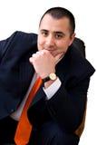 Homem de negócio que senta-se na cadeira Imagem de Stock Royalty Free