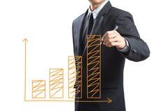 Homem de negócio que tira um gráfico crescente Foto de Stock