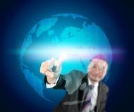 Homem de negócio que toca no mundo Foto de Stock Royalty Free