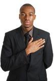 Homem de negócio que toma um juramento fotos de stock royalty free