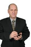 Homem de negócio que usa PDA Fotografia de Stock Royalty Free